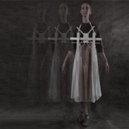 Woman in a dress wearing a white cross
