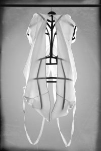A transparent sheer dress with steel construction underneith